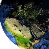 EMEA region on Earth at night with exaggerated mountains. EMEA region on model of Earth with exaggerated surface features including ocean floor. 3D illustration Stock Photo