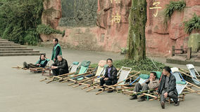 Emei China-Some men are engaged in the slide bar Stock Photo