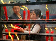 Emeishan, China: Lighting Candles at Temple Royalty Free Stock Photo