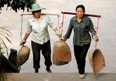 Emeishan, China: Woman with Shoulder Yokes Royalty Free Stock Image