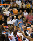Emeka Okafor Goes For The Rebound. Emeka Okafor of the Charlotte Bobcats goes for a rebound during a game against the Detroit Pistons at the The Palace Of Auburn Stock Photography
