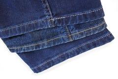Emendas brilhantes da linha na calças azul da sarja de Nimes Foto de Stock Royalty Free