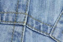 Emendas em uma tela das calças de brim Fotografia de Stock Royalty Free
