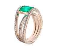 Emerald. Gold a ring with brilliants and an emerald Royalty Free Stock Image