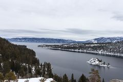 Emerald Bay Lake Tahoe, ca. Lake Tahoe`s Emerald Bay with Fannatte Island covered in snow. Slightly overcast skys royalty free stock images