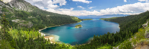 Emerald Bay, Lake Tahoe. Emerald Bay panorama with boats cruising around the island royalty free stock image