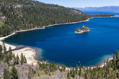 Emerald Bay, Lake Tahoe. View of emerald bay in Lake Tahoe on a early spring afternoon, a calm lake and fresh green on the trees royalty free stock photo