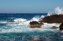 Emerald breaking waves Stock Image