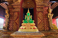 Emerald Buddha with angels. Emerald Buddha model with angels on both sides Royalty Free Stock Photo