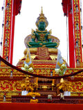 Emerald Buddha shrine, Thailand. Emerald Buddha sat in a detailed shrine one of the most famous statues in Thailand Stock Images