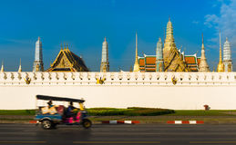 Emerald Buddha Temple with motion Tuk Tuk, Bangkok, Thailand Royalty Free Stock Photos