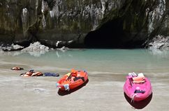 Emerald cave and lonely boats. Lonely canoes on the beach of emerald cave on the ko mook island in thailand Stock Photos