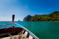 Emerald Cave in Thailand. Emerald Cave Tham Morakot on tropical Koh Mook island in Thailand. Landscape taken from longtailboat on the sea Stock Image