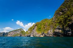 Emerald Cave in Thailand. Emerald Cave Tham Morakot on tropical Koh Mook island in Thailand. Landscape taken from longtailboat on the sea Stock Photo