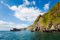 Emerald Cave in Thailand. Emerald Cave Tham Morakot on tropical Koh Mook island in Thailand. Landscape taken from longtailboat on the sea Royalty Free Stock Image