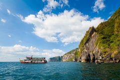 Emerald Cave in Thailand. Emerald Cave Tham Morakot on tropical Koh Mook island in Thailand. Landscape taken from longtailboat on the sea Royalty Free Stock Photography