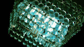 chandelier with emerald crystals Stock Photography