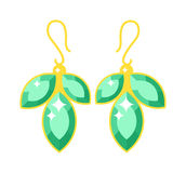 Emerald earrings beautiful gold accessory isolated. Stock Image