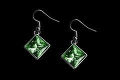 Emerald earrings isolated Stock Photography