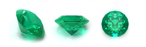 Emerald gems. Three positions on white background stock photo