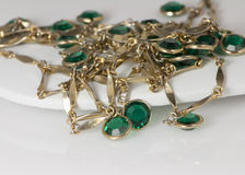 Emerald and Gold Necklace. Emerald Necklace and Gold on White Background Stock Photo