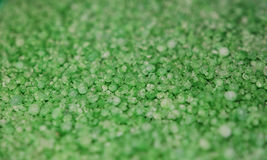Emerald Granules Background. A close up photograph of green granules Royalty Free Stock Images