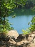 Emerald Green Colored Lake Foto de archivo libre de regalías