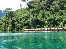 Emerald green Lake huts Stock Image
