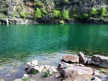 Emerald green lake quarry pond royalty free stock photography