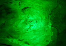 Emerald-green mineral glowing from inside Royalty Free Stock Image