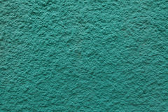 Emerald green painted stucco wall. Royalty Free Stock Images