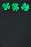 Emerald green paper clover shamrock leafs Royalty Free Stock Photos