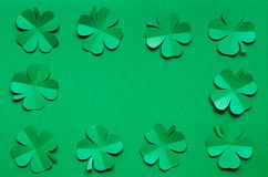 Emerald green paper clover shamrock leafs border frame Stock Photo