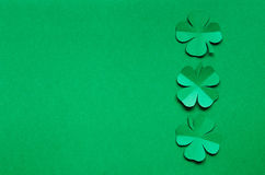 Emerald green paper clover shamrock leafs border frame Stock Image