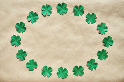 Emerald green paper clover shamrock leafs wreath border Stock Photo