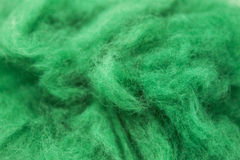 Emerald  green piece of Australian sheep wool Merino breed close-up on a white background Stock Images