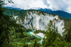 Emerald Green River Meandering through Pine Tree Forest and Rock stock image