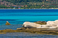 Emerald green sea water at coast of small uninhabited island near coast of Sithonia Royalty Free Stock Photo