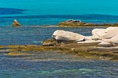 Emerald green sea water at coast of small uninhabited island near coast of Sithonia Royalty Free Stock Photography