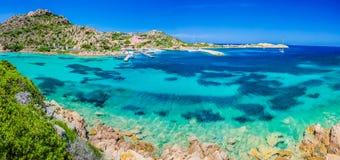 Emerald green sea water and rocks on coast of Maddalena island, Sardinia, Italy Royalty Free Stock Photography