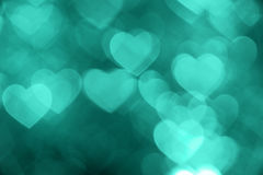 Emerald heart bokeh background photo, abstract holiday backdrop Stock Photos
