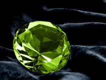 Emerald Jewel. A close up on a Emerald jewel on a dark background. Shallow DOF Stock Images