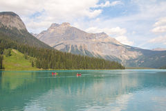 Emerald Lake and Canoes Stock Photography