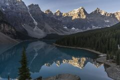 Emerald lake with reflection of mountains