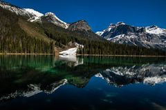 Emerald Lake reflection, Yoho National Park. Herald green water with last of snow reflected Stock Photos