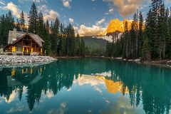 Nice view of emerald green lake with sunset sky in the mountains stock photos