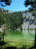 Emerald Mountain Lake. Emerald waters of Cliff Lake in Lassen Volcanic National Park Royalty Free Stock Image