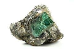Emerald. Nestled in bedrock found in Muzo/ Colombia stock image