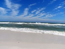 Florida Gulf Coast Beach Emerald Ocean Waves. White caps of Emerald waters of the Florida Coast Royalty Free Stock Image