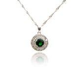 Emerald pendant isolated on white Stock Photo